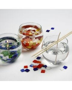 Gel candle decorated with glass mosaic tiles