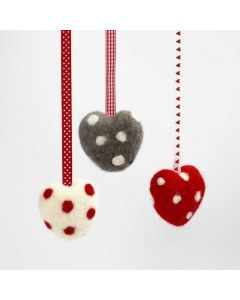A Needle Felted Heart with Dots and a Decorative Ribbon