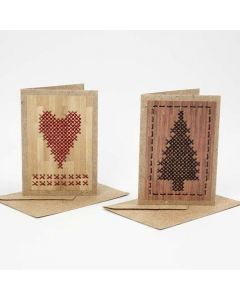 A Greeting Card from Natural Paper with Cross Stitches