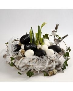A Wreath made from Branches with Feathers & Goose Eggs with Text