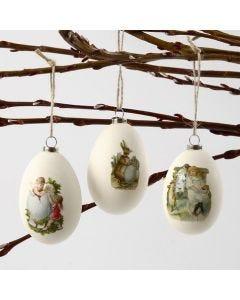 Hanging Goose Eggs with glued-on Vintage Die-Cuts