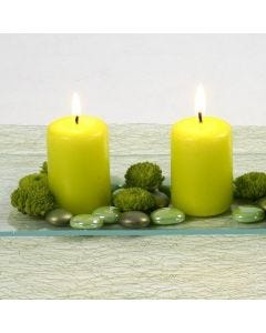 Lime-coloured Pillar Candles and Glass Deco Stones on a Glass Dish