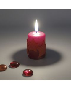A Pillar Candle with Beeswax Stars