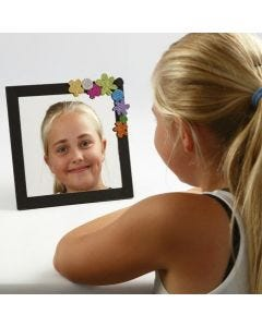 A Mirror in a painted Frame decorated with Foam Rubber