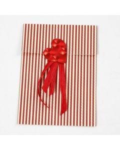 A Foil Heart and Gift Ribbon on a Vivi Gade Design Paper Bag