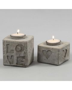 Cast Candle Holders with Letters and Shapes in Relief