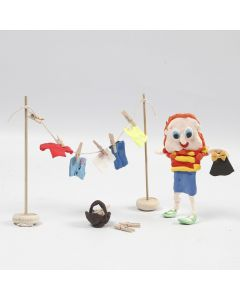 A Figure from Silk Clay and a wooden Clothes Horse with Clothes from Silk Clay with Clothes