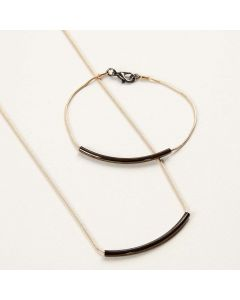 Jewellery made from articulated Chains with curved Tube Pendants