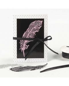 A patterned Card decorated with a die-cut Paper Feather