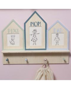 A decorated Coat Rack with framed Drawings