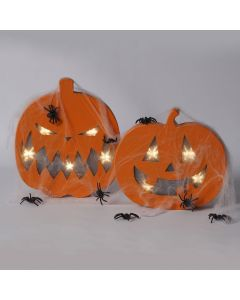 A painted Pumpkin Head with built-in lights