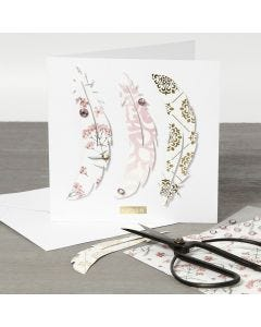 A Greeting Card with Design Paper Feathers on the Front