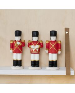 A Terracotta Nutcracker decorated with Plus Color