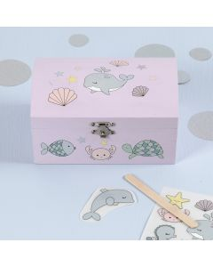 Rub-on Stickers with Sea Creature Designs on a wooden Treasure Chest