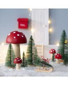 The Elf stands a Christmas Tree in front of his Elf's Door