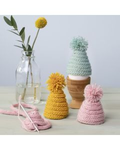 A knitted Egg Warmer from knitted Tube with a Pom-pom