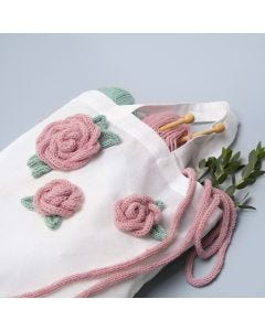 A Shopping Bag decorated with knitted Tube Roses