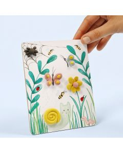 A picture with a natural design decorated with Silk Clay
