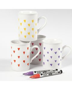 Porcelain mugs decorated with hearts using glass & porcelain markers