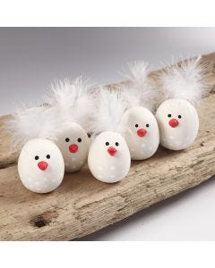 Easter chicks from self-hardening clay with a feather for the tail