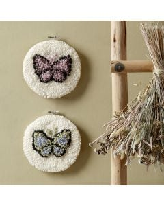 Punched needle embroidered butterflies in an embroidery frame