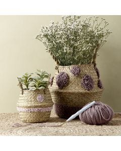 A basket with punch needle embroidered designs