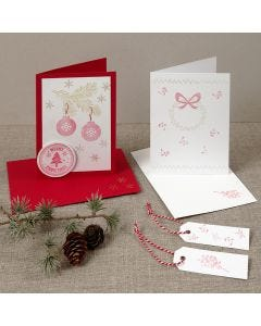 A Christmas card with stamped designs