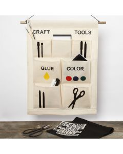 A hanging organiser with pockets for arts and crafts items