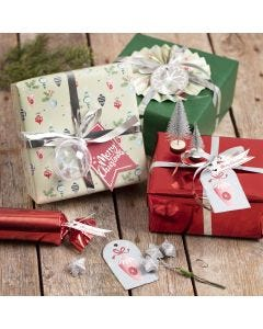 Gift wrapping with Christmas decorations