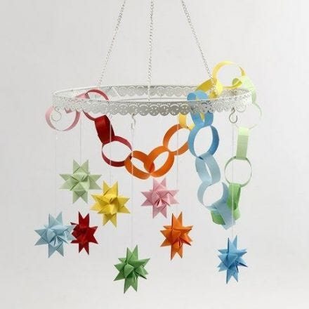 A Metal Loop with coloured Woven Stars and a Paper Chain