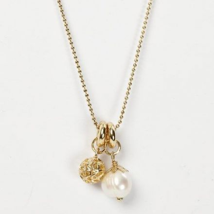 A Gold Bead Chain Necklace with Charms in a Pendant