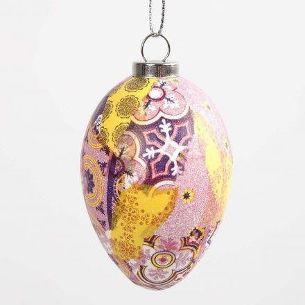 An Egg with patterned Decoupage in pink Harmony