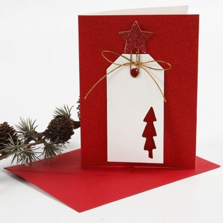 A glittery Greeting Card with a Manilla Tag in a decorative Metal Clip