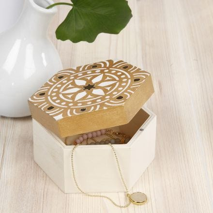 A wooden Storage Box decorated with a stencilled Ethnic Design