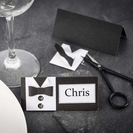 A Place Card for a Confirmation Party with a Shirt and Bow Tie made from textured Paper