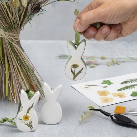 Easter hanging porcelain decorations with dried flowers