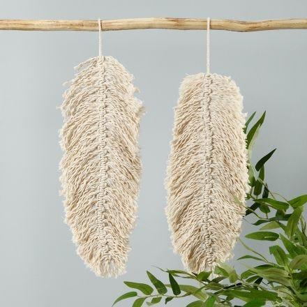 A macramé hanging decoration shaped like a leaf