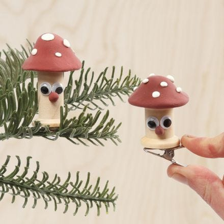 Toadstools made from bobbins decorated with Silk Clay and googly eyes