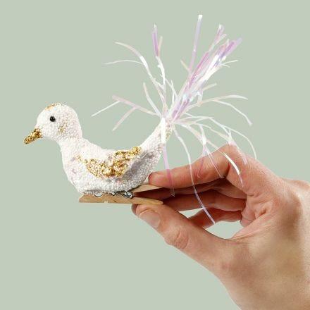 A Foam Clay bird on a wooden peg