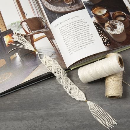 A braided book mark made from bamboo cord