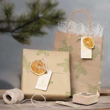 Gift wrapping with stamped designs and natural materials