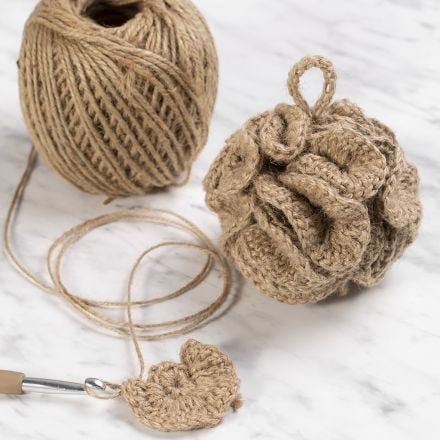 A crocheted bath sponge from natural twine