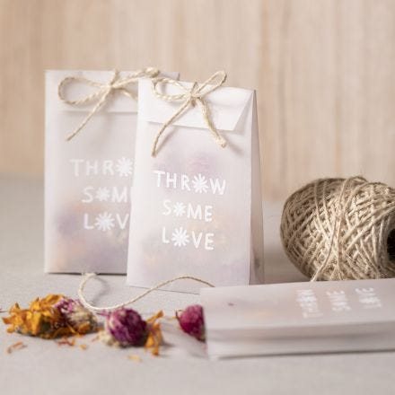A vellum paper bag with dried flowers for confetti