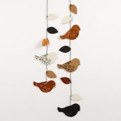 A die-cut Mobile, with embossed and printed Birds