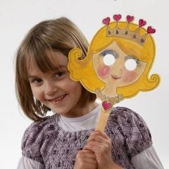 A Painted Wooden Mask on a Stick