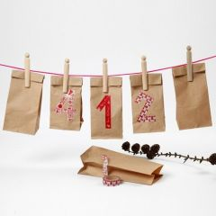 A Calendar made from Paper Bags with Masking Tape Numbers
