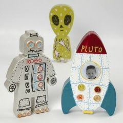 A painted and decorated Papier-Mâché Space Rocket and Aliens