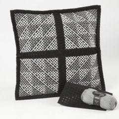 A Cushion with a graphic Cross-Stitch Pattern