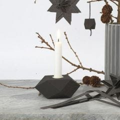 A black-painted geometrically shaped Candlestick