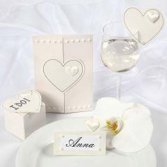 Satin Hearts on a Wedding Invitation and Wedding Decorations